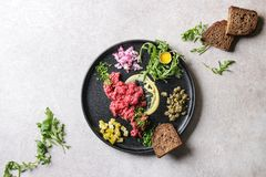 Beef tartare with quail egg royalty free stock images
