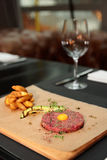 Beef tartare on reastaurant table Royalty Free Stock Image