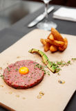 Beef tartare on restaurant table Stock Photo