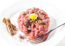Beef tartare with spices, onions and capers Stock Photography