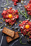 Beef tartare with toasts Stock Image
