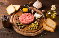 Beef tartare on wooden table Stock Images