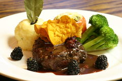 Beef Tenderloin. Served with Blackberry jus royalty free stock image