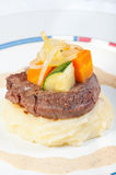 Beef tenderloin with mash potatoes and buttered vegetables Royalty Free Stock Photography