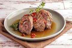 Beef tenderloin rolls stuffed stock photos