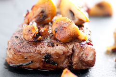 Beef tenderloin steak with mushrooms Royalty Free Stock Photo