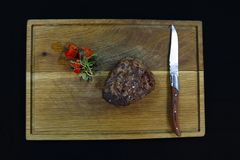 Beef tenderloin steak in a wooden board royalty free stock images