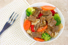 Beef teriyaki with fork and napkin Stock Image