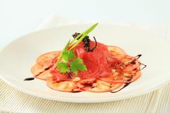 Beef and tomato carpaccio Stock Photography