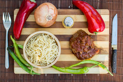 Beef with tomato sauce, sphagetti and vegetables. Royalty Free Stock Images