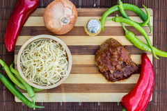 Beef with tomato sauce, sphagetti and vegetables. Stock Photos
