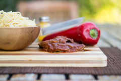 Beef with tomato sauce, sphagetti and vegetables. Royalty Free Stock Photography