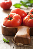 Beef tomatoes and basil leaves Royalty Free Stock Photo