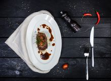 Beef tongue with celery root sauce and tomatoes. stock photos