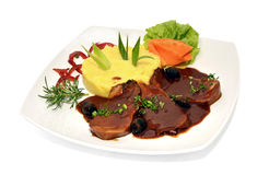 Beef tongue. With mashed potatoes, carrots and greenery Royalty Free Stock Photo