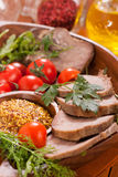 Beef tongue on plate Stock Photo