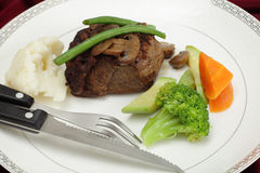 Beef tournedos with cutlery Stock Images