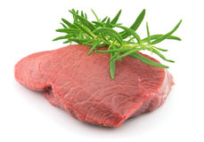 Beef with twig of rosemary Royalty Free Stock Photo