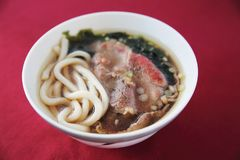 Beef Udon noodles. On a bowl stock images