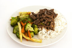 Beef and veg stir-fry. Stir-fried oriental beef with stir-fried veg and boiled rice Stock Images