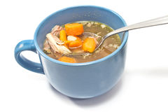 Beef and vegetable broth in  bowl with spoon Royalty Free Stock Image