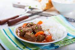 Beef and vegetable casserole served with rice Stock Photos