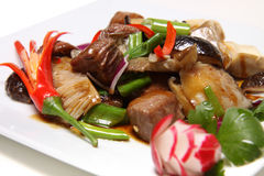 Beef with vegetables. Beef with fresh vegetables and chili on a white plate royalty free stock photography