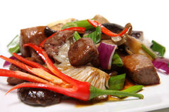 Beef with vegetables. Beef with fresh vegetables and chili on a white plate stock photography