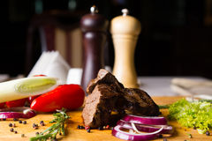 Beef and Vegetables on Cutting Board Royalty Free Stock Photos