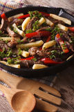 Beef with vegetables and French fries in a pan close-up vertical Stock Photography