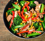 Beef and vegetables stir fry on wooden table. Stock Photos