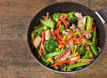 Beef vegetables stir fry on wooden table. Stock Photos