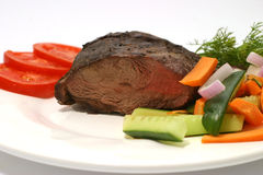 Beef and vegetables with tomatoes Stock Photography