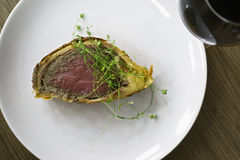 Beef Wellington and wine Royalty Free Stock Images