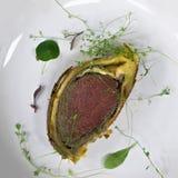 Beef Wellington on plate overhead Stock Images