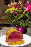 Beef Wellington Sliced and Flowers Stock Photography