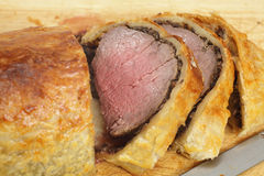 Beef Wellington slices on a board Royalty Free Stock Photo