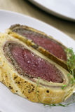 Beef Wellington slices on plate Stock Images