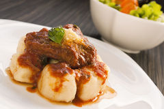 Beef With Sauce And Gnocchi Royalty Free Stock Image