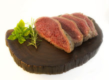 Beef on wooden board. Royalty Free Stock Image
