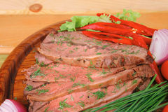Beef on wooden plate Stock Photo