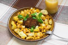 Beefburger with fried potato with maize Stock Image