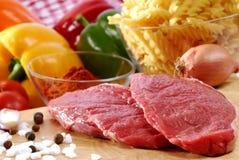 Beefsteak. Raw beefsteak on a kitchen board royalty free stock image