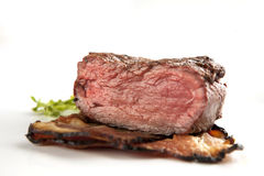Beefsteak. With bacon and salat stock photos