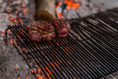 Beefsteak on a charcoal (wooden) grill. Steakhouse making beefsteak on a charcoal grill Stock Photos