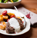 Beefsteak with cream sauce. Beefsteak with roasted potatoes and cream sauce stock images