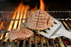 Beefsteak on Flaming Grill Royalty Free Stock Images