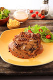 Beefsteak. A beefsteak is a flat cut of beef, usually cut perpendicular to the muscle fibers stock images