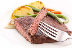 Beefsteak on Fork Royalty Free Stock Images