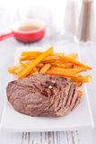 Beefsteak and french fries Stock Image